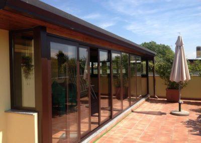 Veranda in alluminio con serramenti scorrevoli a taglio termico